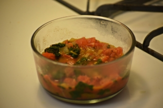 Mixture of Swiss chard, tomatoes, onions, and spices